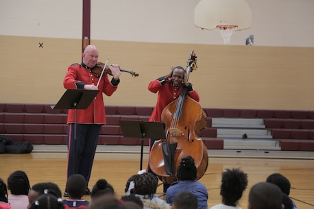 """On Oct. 25, 2018, a string duo from """"The President's Own"""" U.S. Marine Band presented a Music in the Schools program at the Benjamin D. Foulois Creative and Performing Arts Academy in Suitland, Md. (U.S. Marine Corps photo by Master Sgt. Kristin duBois/released)"""
