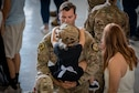 Tech. Sgt. Cliff Coppenbarger, 823d Base Defense Squadron (BDS) squad leader, holds his daughter during a redeployment ceremony, Oct. 26, 2018, at Moody Air Force Base, Ga. The 822d, 823d and 824th BDS's provide high-risk force protection and integrated base defense for expeditionary air forces. Airmen from the 823d BDS just returned home from conducting relief-in-place in the United States Africa Command theater while Airmen from the 824th BDS took their place. (U.S. Air Force photo by Airman Taryn Butler)