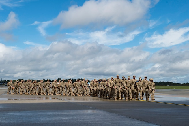 The 823d Base Defense Squadron (BDS) march on the flightline during a redeployment, Oct. 26, 2017, at Moody Air Force Base, Ga. The 822d, 823d and 824th BDS's provide high-risk force protection and integrated base defense for expeditionary air forces. Airmen from the 823d BDS just returned home from conducting relief-in-place in the United States Africa Command theater while Airmen from the 824th BDS took their place. (U.S. Air Force photo by Senior Airman Janiqua P. Robinson)