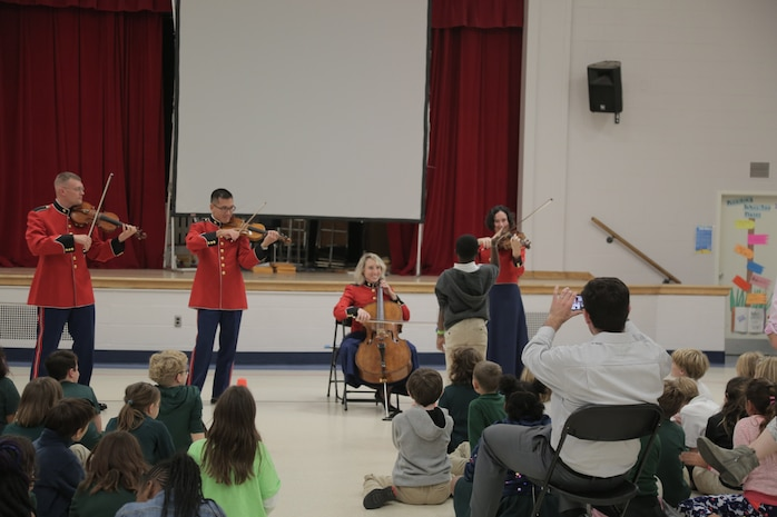 """On Oct. 17, 2018, a string quartet from """"The President's Own"""" U.S. Marine Band performed a Music in the Schools program at Brent Elementary School in Washington, D.C. (U.S. Marine Corps photo by Master Sgt. Kristin duBois/released)"""