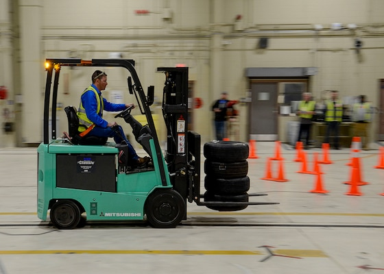 "Equipment Specialist David Gwartney, of the DLA Disposition Services at Arifjan site in Kuwait, navigates the ""Rubber Meets the Road"" challenge on his way to a 2nd place finish at the inaugural Material Handling Equipment Rodeo in Battle Creek Oct. 25."