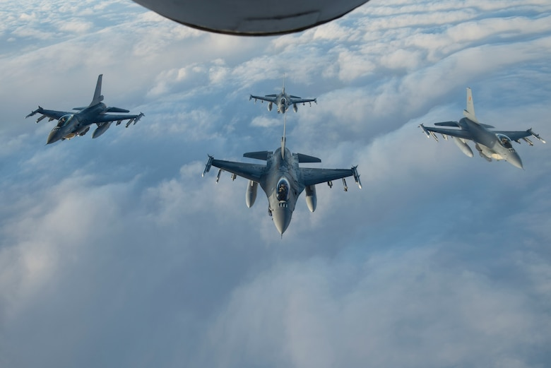 Four Belgian Air Force F-16 Fighting Falcons fly in formation behind a U.S. Air Force KC-135 Stratotanker during Exercise Trident Juncture 18, in Swedish airspace, Oct. 30, 2018. The NATO-led exercise includes 31 countries and provides unique opportunities to train with NATO allies and partners. (U.S. Air Force photo by Senior Airman Luke Milano)