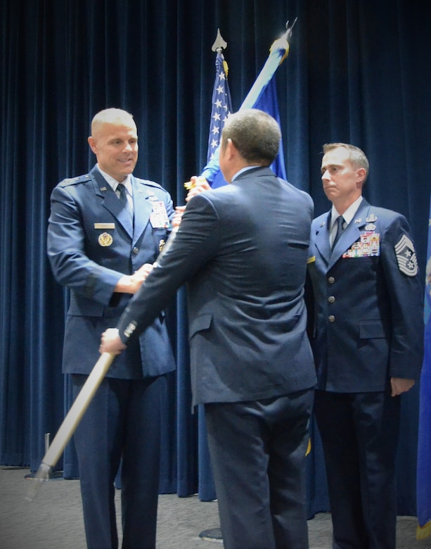 Edwin Oshiba relinquishes the Air Force Civil Engineer Center flag to Maj. Gen. Bradley D. Spacy, Commander, Air Force Installation and Mission Support Center during a change of leadership ceremony at Lackland Air Force Base, Texas, Oct. 29, 2018.