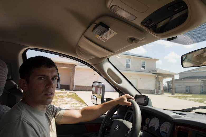 1st Lt. Adam Kriete, 337th Air Control Squadron student, drives through his neighborhood to inspect damage, at Tyndall Air Force Base, Fla., Oct. 19, 2018. Tyndall AFB was damaged by Hurricane Michael which displaced approximately 11,000 people, to include the Kriete family who travelled back to Tyndall during a five hour window to recover their belongings.