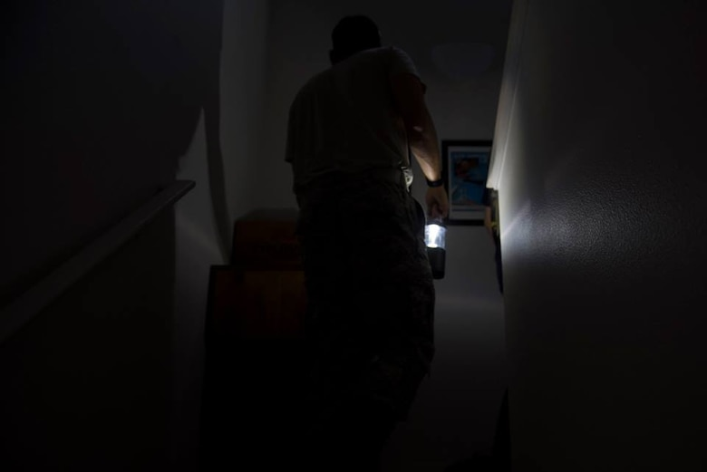 1st Lt. Adam Kriete, 337th Air Control Squadron student, searches for personal items in his home, at Tyndall Air Force Base, Fla., Oct. 19, 2018. Tyndall AFB was damaged by Hurricane Michael which displaced approximately 11,000 people, to include the Kriete family who travelled back to Tyndall during a five hour window to recover their belongings.
