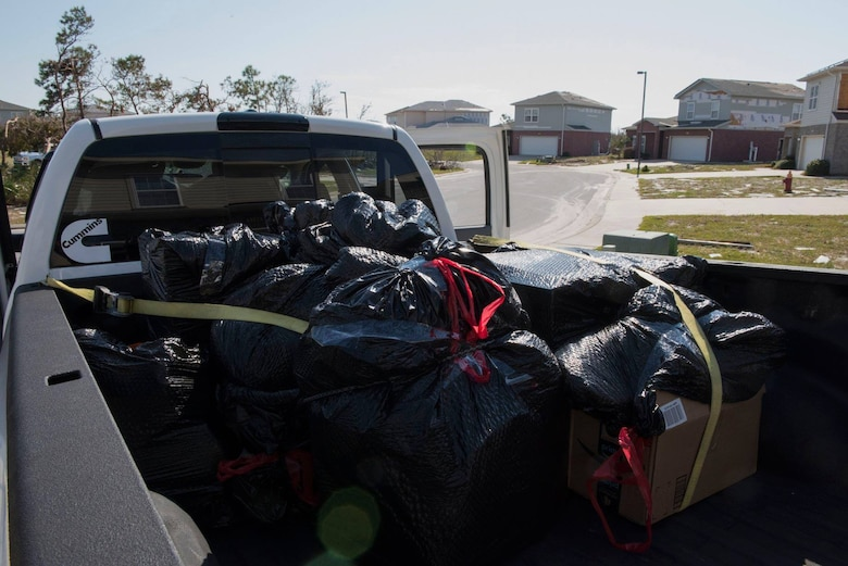 The Kriete family salvages their personal belongings, at Tyndall Air Force Base, Fla., Oct. 19, 2018. Tyndall AFB was damaged by Hurricane Michael which displaced approximately 11,000 people, to include the Kriete family who travelled back to Tyndall during a five hour window to recover their belongings.