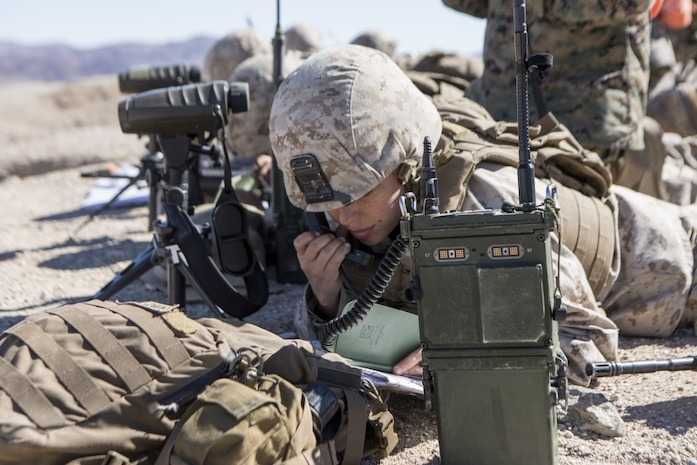 U.S. Marine Corps Sgt. Sarah Brinkerhoff, a forward observer with Fire Support Team, Company A, 1st Battalion, 8th Marine Regiment (1/8), 2nd Marine Division, communicates with the mortar gun line during Integrated Training Exercise (ITX) 1-19 at Twentynine Palms, Calif., Oct 19, 2018. The large-scale exercise allows infantry units to bolster their combat capabilities in a desert environment in preparation for potential global contingencies. (U.S. Marine Corps photo by Lance Cpl. Tyler M. Solak)