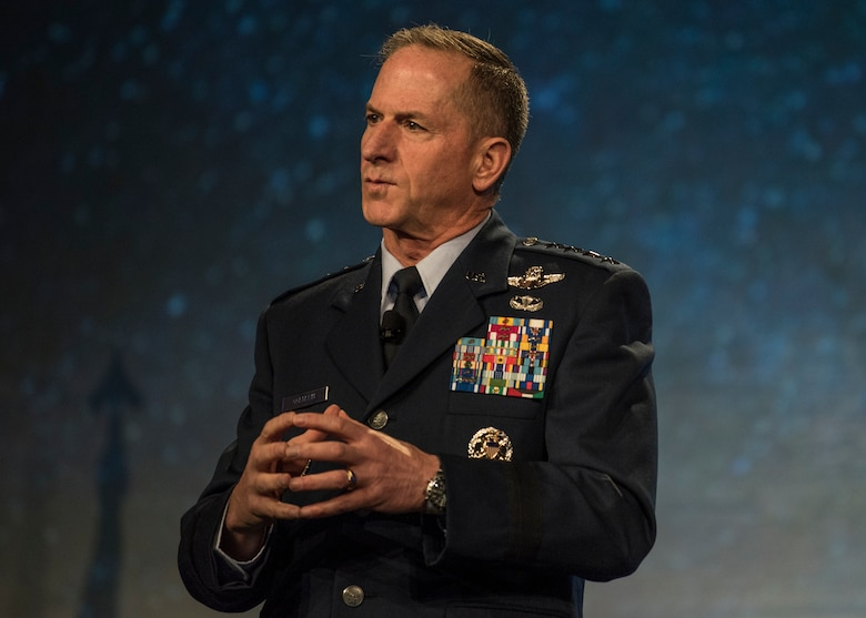 "Air Force Chief of Staff Gen. David L. Goldfein speaks during the Airlift/Tanker Association Symposium in Grapevine, Texas, Oct. 26, 2018. ""We have a federated enterprise that analyzes intelligence to a level of sophistication that's absolutely exquisite,"" said Goldfein. But Goldfein says it doesn't stop there, and wants to embrace multi-domain command and control to dominate the information environment faster and smarter. ""Our flight plan in the future uses machine-to-machine capabilities, smart-learning algorithms, and tools of the trade to pull together this network of capability that can cross-cue, connect, and compare to databases and learn as we go so that the decision of what's of interest is made at the machine level. And then let's repurpose our Airmen so that we are doing the refined, human part, which is to say, 'Okay now let's turn this information that I know is of interest into decision-quality information that allows us to operate faster than our adversaries.' That's where we're headed."" A/TA provides mobility Airmen a professional development forum to engage with industry experts within the mobility enterprise, attend seminars focused on mobility priorities, and listen to leadership perspectives from top leaders in the Air Force and Department of Defense. (U.S. Air Force photo by Tech. Sgt. Jodi Martinez)"