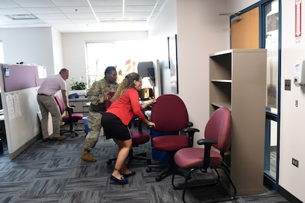Army Reserve Soldiers and staff members barricade a main doorway during an active shooter training exercise at the command headquarters, Oct. 30, 2018.