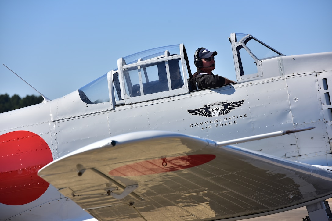 man sitting in plane with hatch open