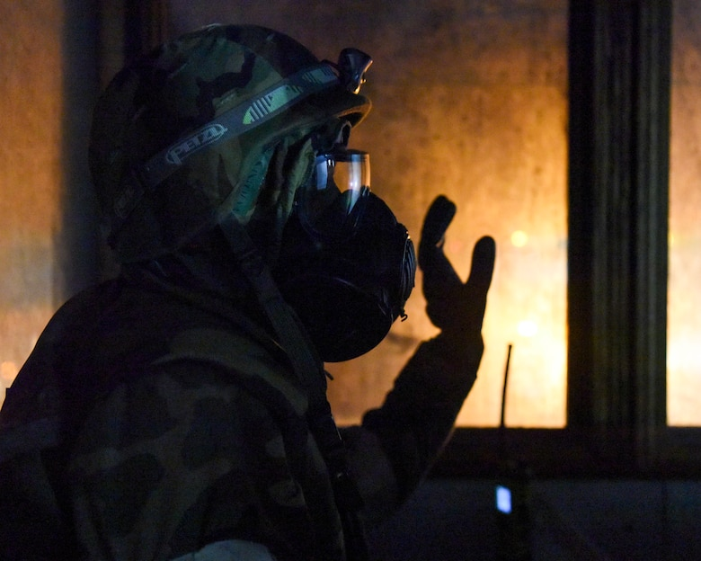 U.S. Air Force Senior Airman Mark Mugo, 773d Civil Engineer Squadron, puts on protective gear during exercise Polar Force 19-1 at Joint Base Elmendorf-Richardson, Alaska, Oct. 25, 2018. Exercise Polar Force showcases unit combat readiness while fighting in chemical, biological, radiological and nuclear defense protective gear.