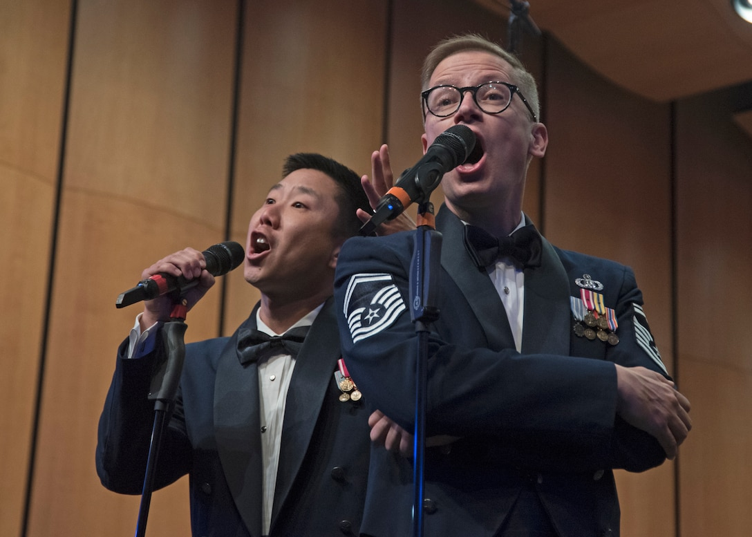 Master Sgt. Benjamin Park, left, and Senior Master Sgt. Ryan Dolan, right, U.S. Air Force Band's Singing Sergeants vocalists, perform at the I.M. Terrell Academy in Fort Worth, Texas, Oct. 26, 2018. The band aims to inspire patriotism and service, as well as honor veterans. (U.S. Air Force photo by Senior Airman Abby L. Richardson)