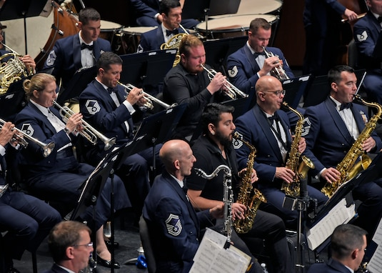 Members of the U.S. Air Force Band perform alongside University of Texas Permian Basin band students at the Wagner Noël Performing Arts Center in Midland, Texas, Oct. 21, 2018. The band aims to inspire patriotism and service, as well as honor veterans. (U.S. Air Force photo by Senior Airman Abby L. Richardson)