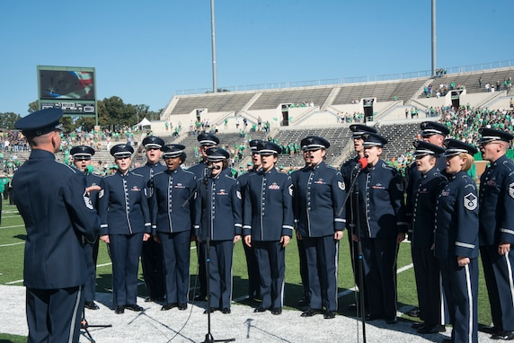 The U.S. Air Force Band's Singing Sergeants perform the National Anthem before a University of North Texas football game at Apogee Stadium in Denton, Texas, Oct. 27, 2018. Band performances aim to positively impact the community and inspire patriotism. (U.S. Air Force photo by Senior Airman Abby L. Richardson)