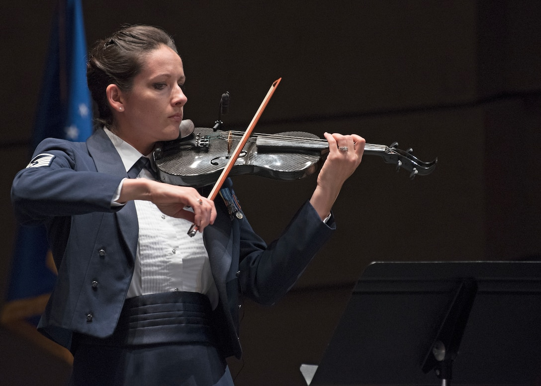 Master Sgt. Emily Wellington, U.S. Air Force Band's Singing Sergeants vocalist and violinist, performs at the Wagner Noël Performing Arts Center in Midland, Texas, Oct. 21, 2018. The band aims to inspire patriotism and service, as well as honor veterans. (U.S. Air Force photo by Senior Airman Abby L. Richardson)