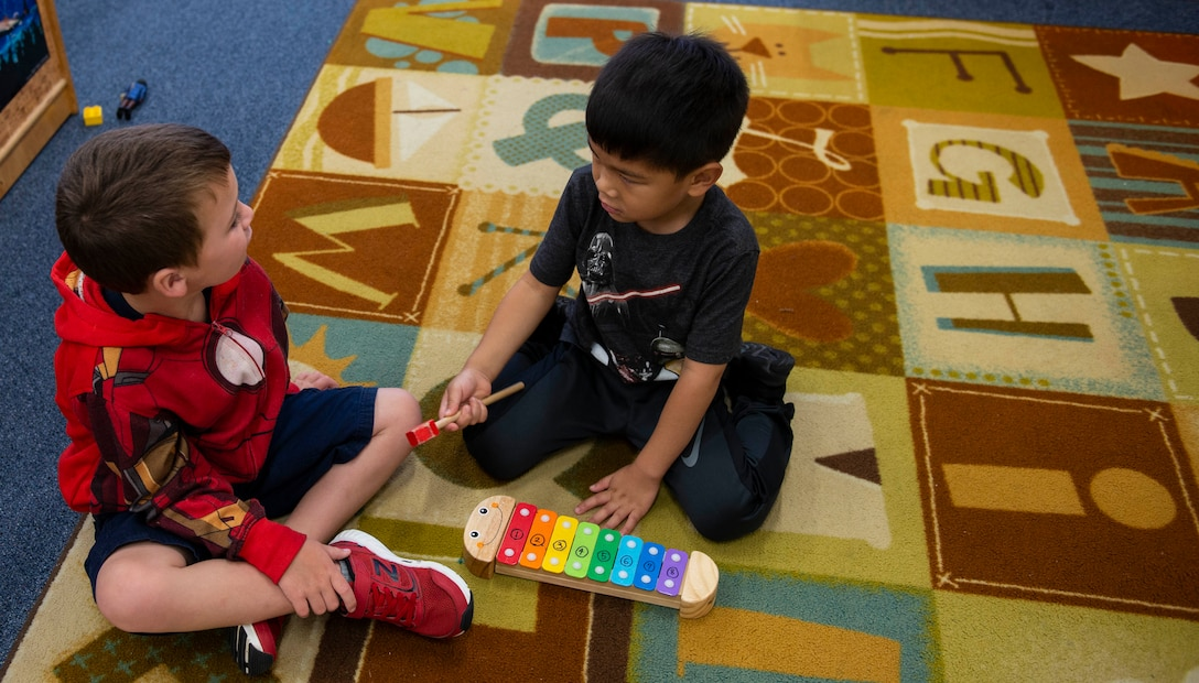 Bryden Kennedy and Emery Esperanza play together at the Wakaba Child Development Center at Kadena Air Base, Japan, Oct. 12, 2018. During the day children are given time to just be kids and play — whether it be as individuals or in group settings.