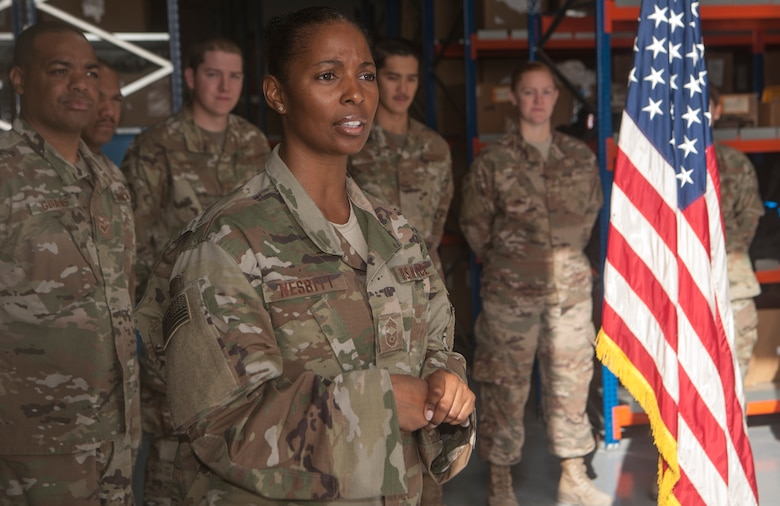 Chief Master Sgt. Anitra Nesbitt, 379th Expeditionary Logistics Readiness Squadron materiel management flight chief, thanks Airmen of the 379th ELRS for their hard work during a ribbon cutting ceremony commemorating the grand opening of the new Desert Depot Oct. 30, 2018, at Al Udeid Air Base, Qatar. The ceremony completes a two-year effort to relocate to a $1.1 million facility. Airmen of the 379th ELRS pulled together to move 42,000 assets to the new location during a four-day period. (U.S. Air Force photo by Tech. Sgt. Christopher Hubenthal)