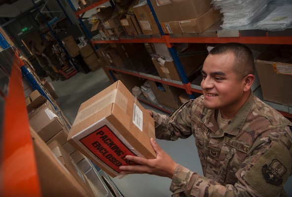 Staff Sgt. Mario Lopez, 379th Expeditionary Logistics Readiness Squadron materiel management craftsman, organizes boxes at the newly relocated Desert Depot Oct. 30, 2018, at Al Udeid Air Base, Qatar. The 379th ELRS recently relocated the Desert Depot, celebrating the moves completion during a ribbon cutting ceremony. The ceremony completes a two-year effort to relocate to a $1.1 million facility. Airmen of the 379th ELRS pulled together to move 42,000 assets to the new location during a four-day period. (U.S. Air Force photo by Tech. Sgt. Christopher Hubenthal)
