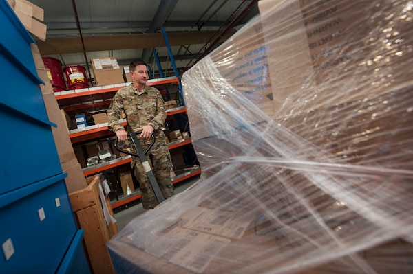 Airman 1st Class Dustin Marin, 379th Expeditionary Logistics Readiness Squadron materiel management technician, moves a pallet of assets at the newly relocated Desert Depot Oct. 30, 2018, at Al Udeid Air Base, Qatar. The 379th ELRS recently relocated the Desert Depot, celebrating the moves completion during a ribbon cutting ceremony. The ceremony culminates a two year effort to relocate to a $1.1 million facility. Airmen of the 379th ELRS pulled together to move 42,000 assets to the new location during a four-day period. (U.S. Air Force photo by Tech. Sgt. Christopher Hubenthal)