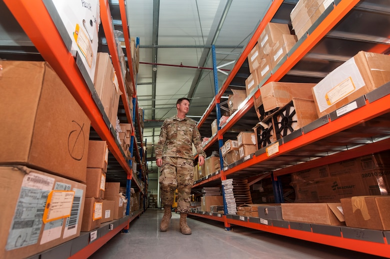 Airman 1st Class Dustin Marin, 379th Expeditionary Logistics Readiness Squadron materiel management technician, organizes assets at the newly relocated Desert Depot Oct. 30, 2018, at Al Udeid Air Base, Qatar. The 379th ELRS recently relocated the Desert Depot, celebrating the moves completion during a ribbon cutting ceremony. The ceremony culminates a two year effort to relocate to a $1.1 million facility. Airmen of the 379th ELRS pulled together to move 42,000 assets to the new location during a four-day period. (U.S. Air Force photo by Tech. Sgt. Christopher Hubenthal)