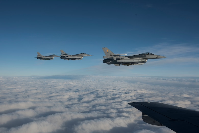 Three Belgian F-16 Fighting Falcons fly alongside a U.S. Air Force KC-135 Stratotanker during Exercise Trident Juncture 18, in Swedish airspace, Oct. 30, 2018. The NATO-led exercise includes 31 countries and provides unique opportunities to train with NATO allies and partners. (U.S. Air Force photo by Senior Airman Luke Milano)