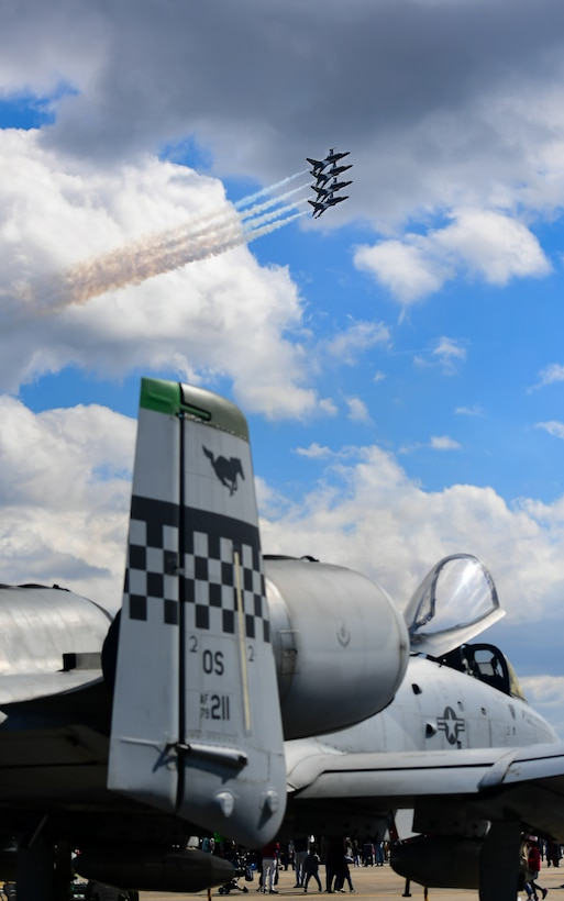 The Republic of Korea's 53rd Demonstration Group, also known as the Black Eagles, fly above an A-10 Thunderbolt II as they perform at the Gyeongnam Sacheon Aerospace Expo at Sacheon Air Base, South Korea, Oct. 25, 2018.