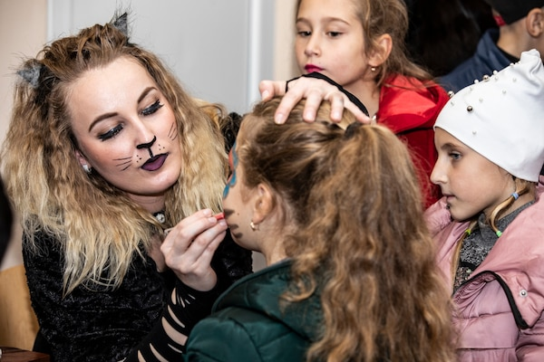 Spc. Kristina Brown of the 278th ACR face paints during the Trick or Treat Halloween event at the Yavoriv Combat Training Center, Ukraine, Oct. 27, 2018.