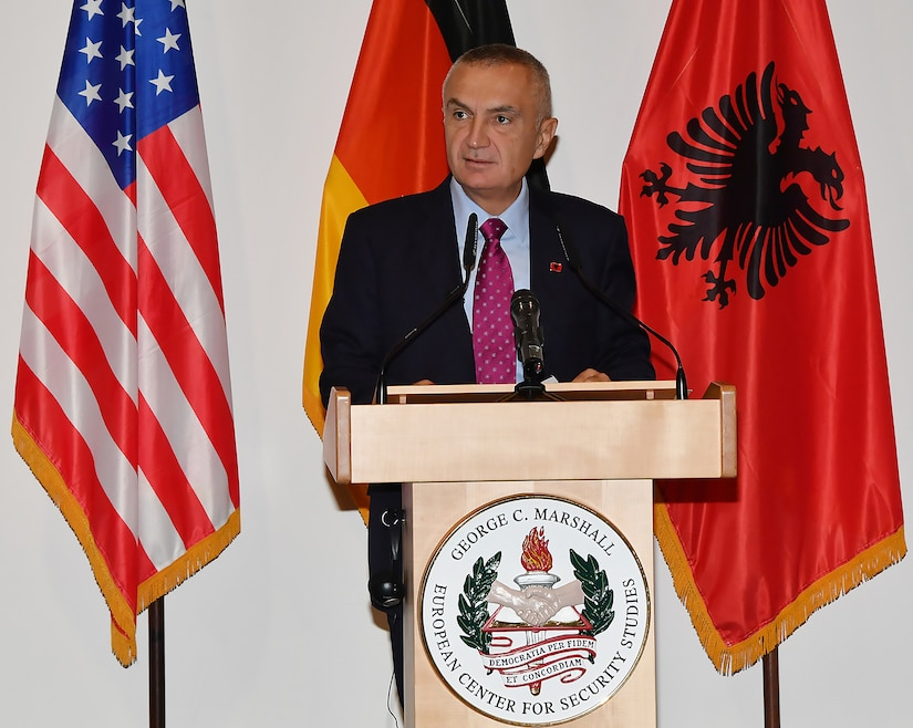 Albanian President Ilir Meta speaks from behind a podium.