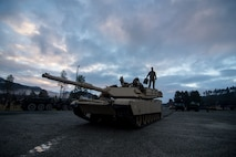 U.S. Marines from 2nd Tank Battalion, 2nd Marine Division, use the early morning daylight to prepare their M1A1 Abrams tank for the Combat Enhancement Training/Force Integration Training phase of Exercise Trident Juncture 18 near Storås, Norway, Oct. 26, 2018. Trident Juncture is a multinational NATO exercise that enhances professional relationships and improves overall coordination with Allied and partner nations.