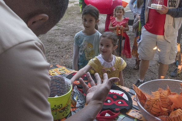 Keesler families enter the Boo Bus during Ghouls in the Park at Marina Park at Keesler Air Force Base, Mississippi, Oct. 26, 2018. The Halloween event also featured a haunted house and various games for children of all ages. (U.S. Air Force photo by Airman 1st Class Suzie Plotnikov)
