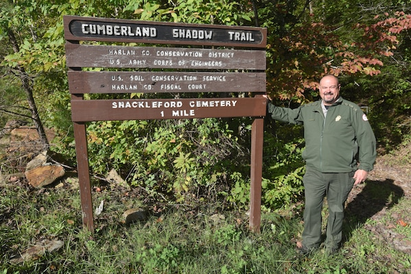 Park Ranger Dave Robinson, U.S. Army Corps of Engineers Nashville District, talked about being safe on the Cumberland Shadow Trail while standing next to the trailhead sign in Smith, Ky., Oct. 18, 2018. The trail is nearly five miles long and winds along the shoreline, hilltops and ridges overlooking Martins Fork Lake. (USACE photo by Lee Roberts)