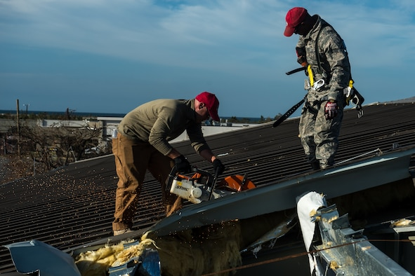 Airmen from 823rd RED HORSE Squadron, perform structural repairs at the gas station Oct. 22, 2018, at Tyndall  Air Force Base, Florida, after Hurricane Michael swept the area.