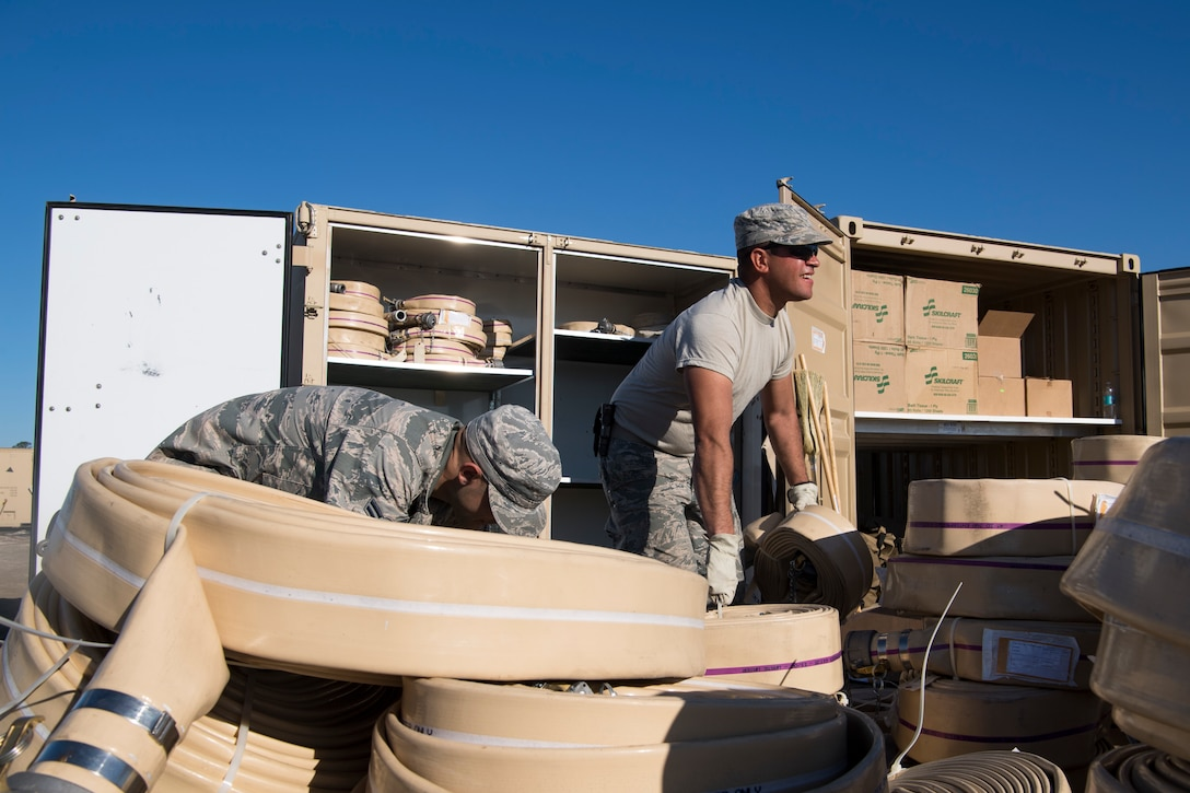 Civil Engineering Airmen move hosing during an equipment consolidation project at Tyndall Air Force Base, Florida, October 28, 2018.