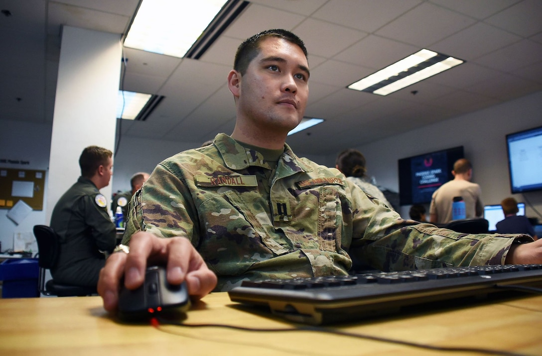 "Capt. Derek Randall, 60th Operations Support Squadron officer in charge of intelligence analysis, participates in a coding challenge hosted by Travis Air Force Base, Calif.'s Phoenix Spark innovation team Oct. 26. Randall's expertise shone through during the challenge leading him to call the challenges, ""fairly simple."" (U.S. Air Force photo by Airman 1st Class Jonathon D.A. Carnell)"