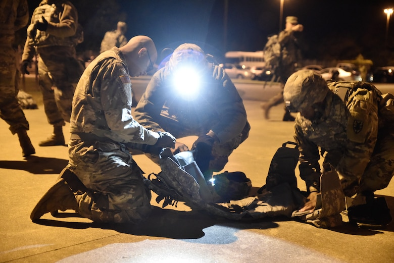 U.S. Army Soldiers from the 331st Transportation Company, 11th Transportation Battalion, 7th Transportation Brigade (Expeditionary), inspect each other's field gear to confirm operability or identify deficiencies during an emergency deployment readiness exercise at Joint Base Langley-Eustis, Virginia, Oct. 22, 2018.