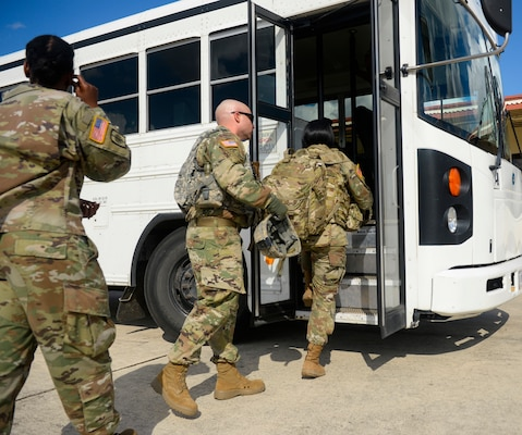 Deployers from Headquarters Company, 89th Military Police Brigade, board a bus in transport to Joint Base San Antonio-Lackland in support of Operation Faithful Patriot Oct. 29. The Headquarters Company, 89th Military Police Brigade,  are deploying Soldiers, equipment and resources to assist the Department of Homeland Security along the southwest border.