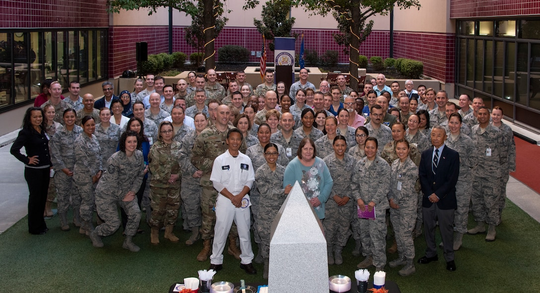 Medical personnel gather together for a group photo, Oct. 30, 2018, Travis Air Force Base, Calif.  David Grant U.S. Air Force Medical Center celebrated its 30th Anniversary with cake and testimonials from past and present patients. DGMC is the Air Force's flagship treatment facility, in the United States, providing a full spectrum of health care and patient-centered treatment to a prime service area throughout eight western states. (U.S. Air Force Photo by Heide Couch)