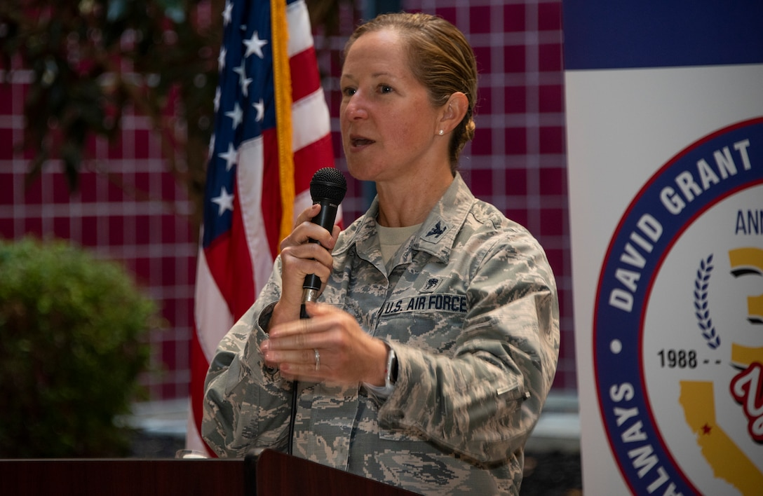 U.S. Air Force Col. Kristen Beals, commander, 60th Medical Group, delivers commentary during a historically significant event, Oct. 30, 2018, Travis Air Force Base, Calif.  David Grant U.S. Air Force Medical Center celebrated its 30th Anniversary with cake and testimonials from past and present patients. DGMC is the Air Force's flagship treatment facility, in the United States, providing a full spectrum of health care and patient-centered treatment to a prime service area throughout eight western states. (U.S. Air Force Photo by Heide Couch)