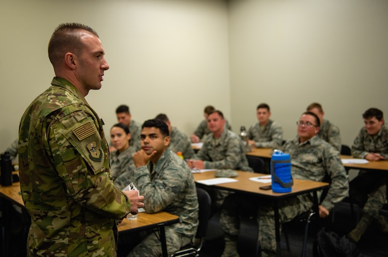 Tech Sgt. Kyle Wilson, First Term Airman Center NCO in charge, speaks to Airmen during an F-TAC Course Oct. 29, 2018, at Luke Air Force Base, Ariz. Luke AFB provides multiple professional development courses that not only provide valuable career information but also fosters an environment for Airmen to share their Air Force experiences amongst their peers. (U.S. Air Force photo by Senior Airman Alexander Cook)
