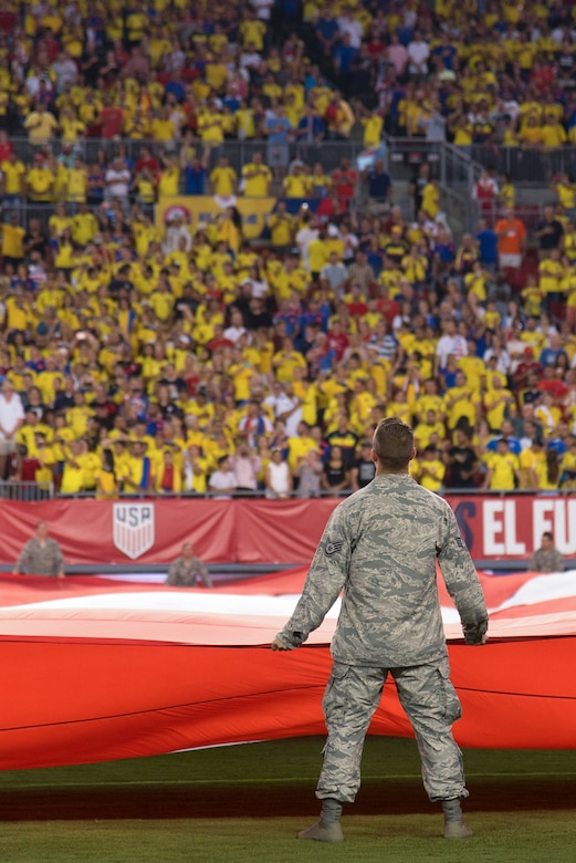 Around 100 military members and their families participate in a flag presentation ceremony before an exhibition match between the U.S. Soccer Men's National Team and the Colombian National Team at Raymond James Stadium, Tampa, Fla., Oct. 11, 2018.  The USMNT provides military members the opportunity to present the American flag before every game.