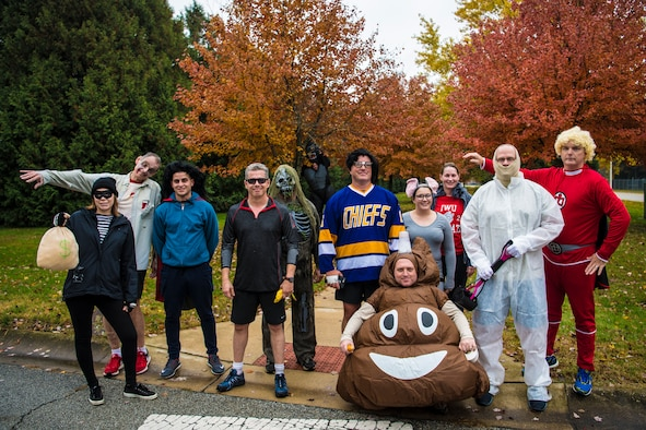 Participants of the Halloween 5K event gather after finishing their run at Grissom Air Reserve Base, Ind., Oct. 31, 2018. Over a dozen runners participated, and attendees were encouraged to run in costume. (U.S. Air Force photo / Senior Airman Harrison Withrow)