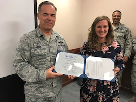 Wing process manager receives green belt certification