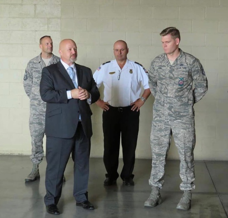 Air Force Fire Chief Jeff Wagner (left) presents Master Sgt. Andrew Kehl, 99th Civil Engineer Squadron deputy fire chief, with a coin at Nellis Air Force Base, Nev. Kehl was named the Department of Defense Senior Fire Officer of the year for 2017. (Courtesy photo)