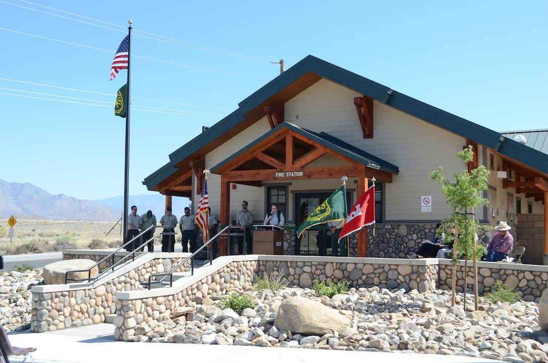 The US Army Corps of Engineers, the US Forest Service and local leaders celebrate the ribbon cutting of the new USFS Fire Station in Lake Isabella, California.