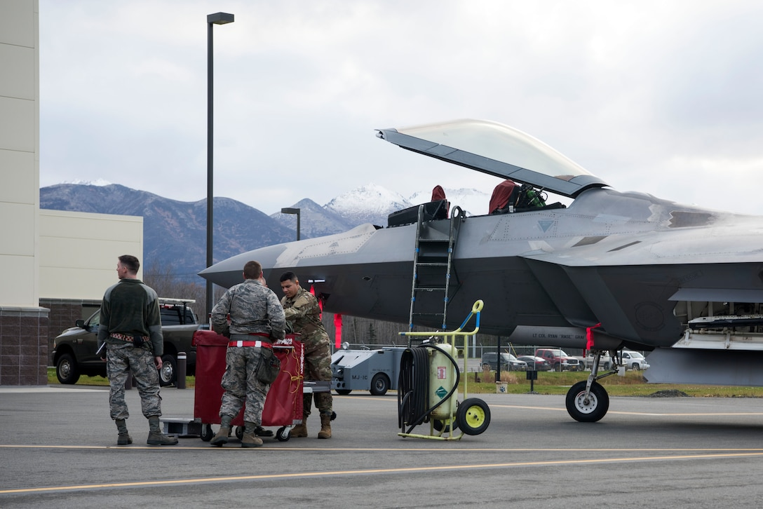 Service members from the 90th Aircraft Maintenance Unit prepare their tools for the quarterly load competition at Joint Base Elmendorf-Richardson, Alaska, Oct. 26, 2018. During the competition, two teams tested their skills as load crew members for the F-22 Raptor. The event demonstrates the skill level and knowledge of all JBER aircraft maintainers.