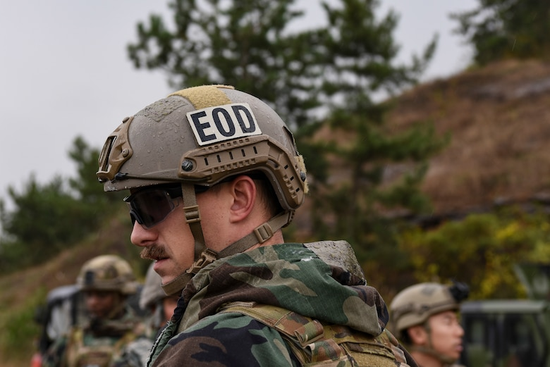 An Explosive Ordnance Disposal Airman from the 8th Civil Engineer Squadron participates in demolition training with an EOD team at Kunsan Air Base, Republic of Korea, Oct. 29, 2018. EOD members are trained to detect, disarm, detonate and dispose of explosive threats all over the world. During the training, EOD detonated multiple charges similar to the ones used to blast open a locked door.  (U.S. Air Force photo by Senior Airman Savannah Waters)