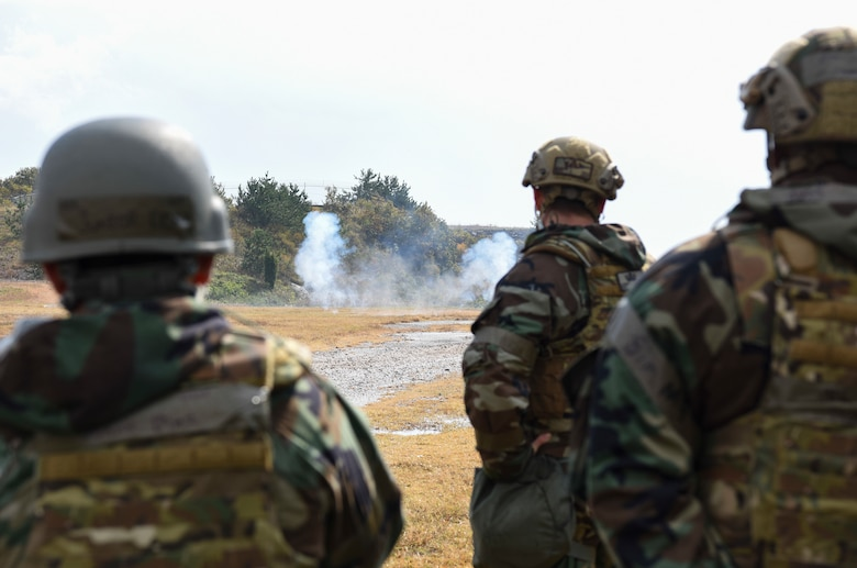 Explosive Ordnance Disposal Airmen from the 8th Civil Engineer Squadron observe training charges detonating at Kunsan Air Base, Republic of Korea, Oct. 29, 2018. EOD members are trained to detect, disarm, detonate and dispose of explosives, routine practice scenarios such as this, help the team improve safety, speed, and efficiency while also reinforcing readiness. (U.S. Air Force photo by Senior Airman Savannah Waters)