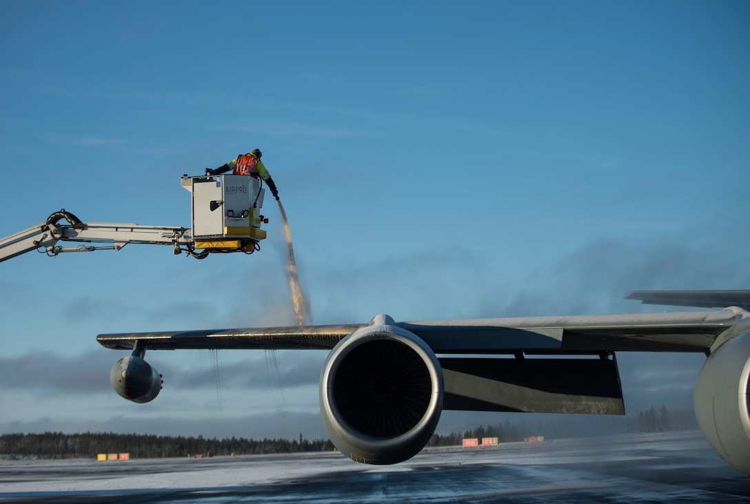 Airport personnel de-ice a U.S. Air Force KC-135 Stratotanker prior to takeoff during Exercise Trident Juncture 18, at Rovaniemi, Finland, Oct. 30, 2018. The exercise is the largest NATO exercise since 2015, and includes more than 50,000 military members from 31 countries. (U.S. Air Force photo by Senior Airman Luke Milano)
