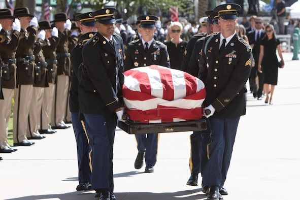 Soldiers carry the flag-draped casket of Sen. John S. McCain III.
