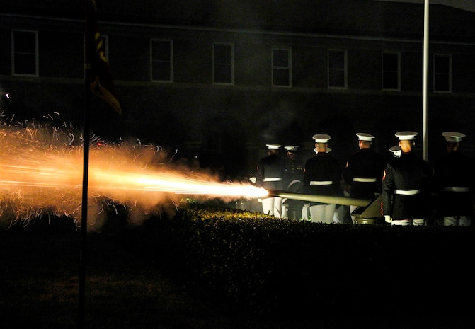 Marine Corps Body Bearers fire canons during an evening parade at Marine Barracks Washington, Washington D.C., Aug. 31, 2018. Commandant of the Marine Corps Gen. Robert B. Neller hosted the parade and the guest of honor was Dr. Betty Moseley Brown.